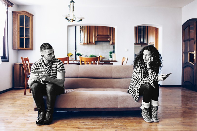 Fighting couple on sofa