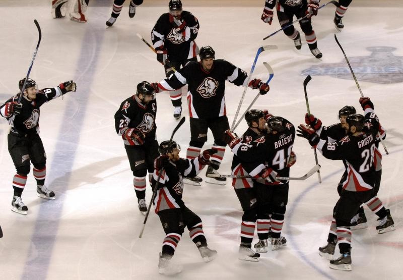 Buffalo Sabres celebrate with Daniel Briere after scoring game-winning overtime goal