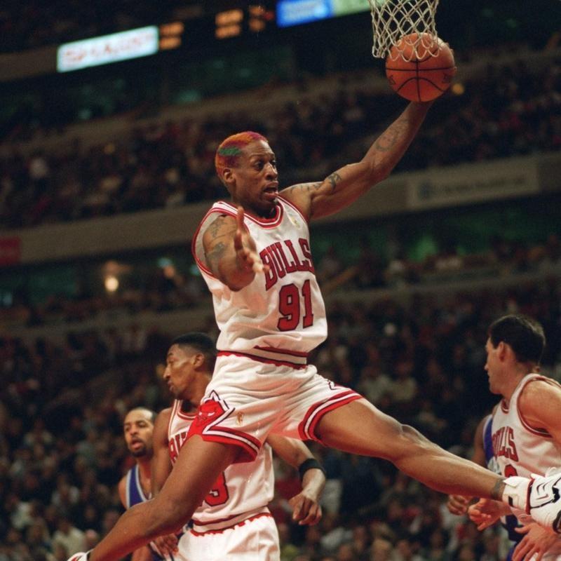 Dennis Rodman rebounds the ball against the Charlotte Hornets