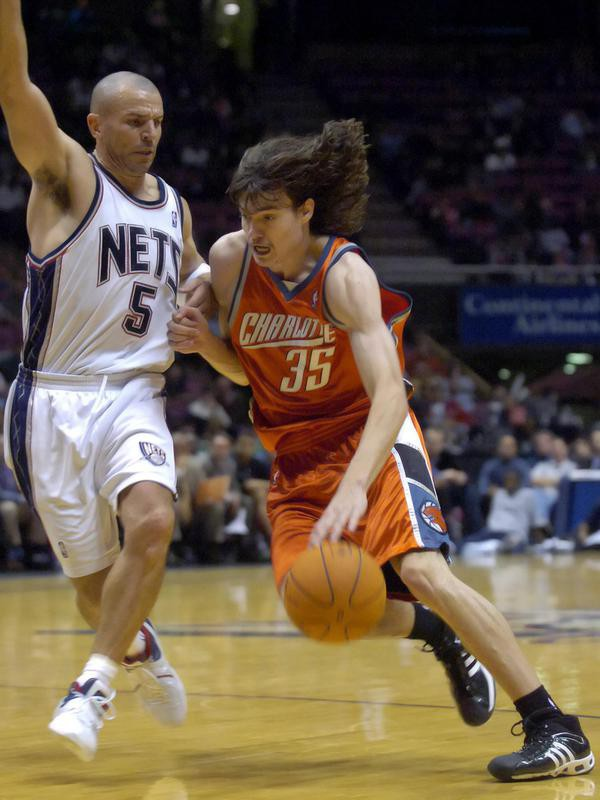 Adam Morrison drives to the basket