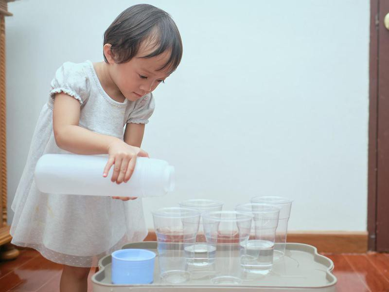 Toddler playing with cups