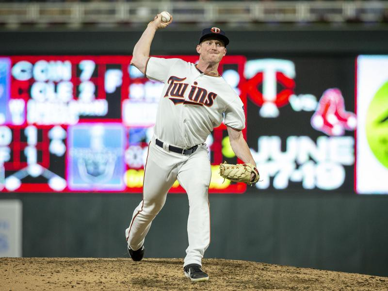 Minnesota Twins relief pitcher Ryan Eades throws to Seattle Mariners