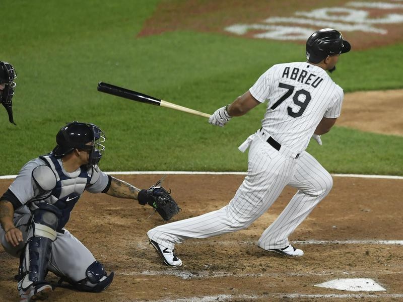 Chicago White Sox's Jose Abreu watches his two-RBI