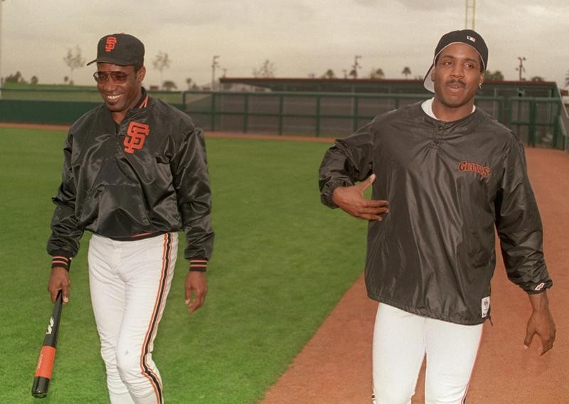 Bobby Bonds interacts with Barry Bonds at spring training in Arizona