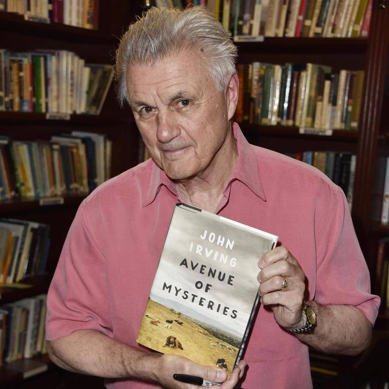 "John Irving poses with book ""Avenue of Mysteries"""