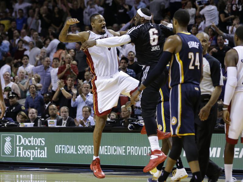 Miami Heat's Rashard Lewis celebrates with Miami Heat's LeBron James