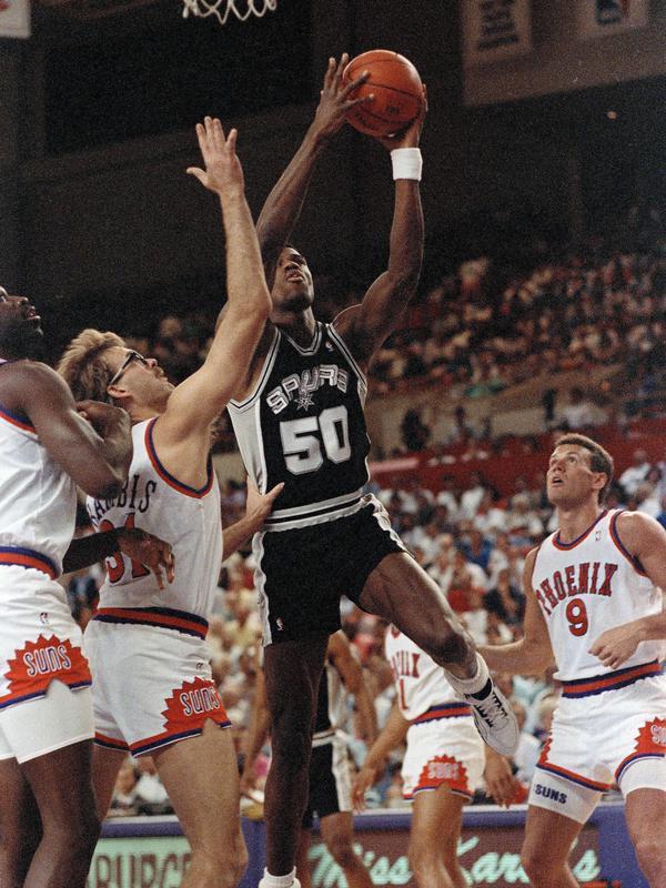 David Robinson drives to the basket