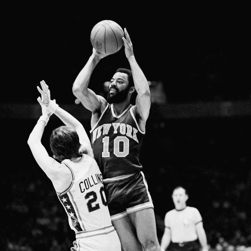 Walt Frazier goes up over 76ers guard Doug Collins