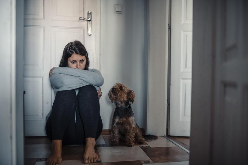 Woman sad with dog
