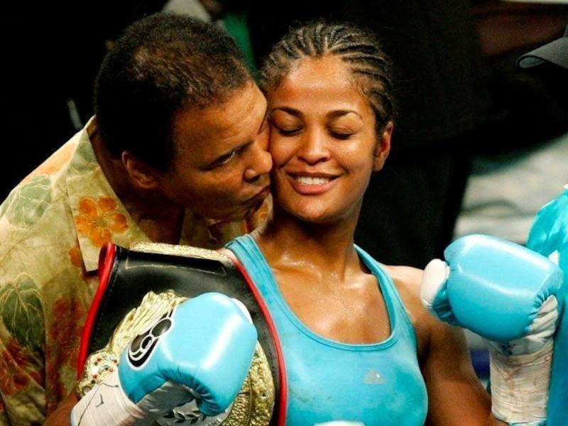 Muhammad Ali embraces Laila Ali