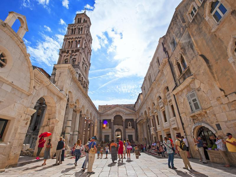 Tourist and locals walking on Peristil of Diocletian's palace