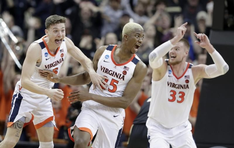 Mamadi Diakite of Virginia reacts after sending game to overtime