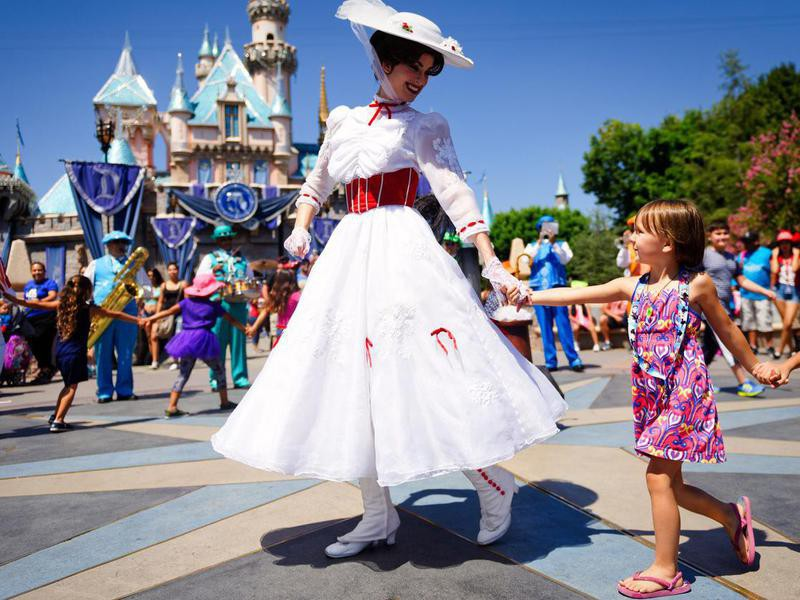Mary Poppins with girl at Disnelyland