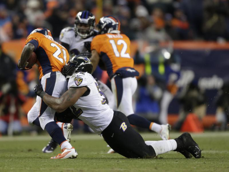 Ray Lewis of the Baltimore Ravens tackles Ronnie Hillman of the Denver Broncos