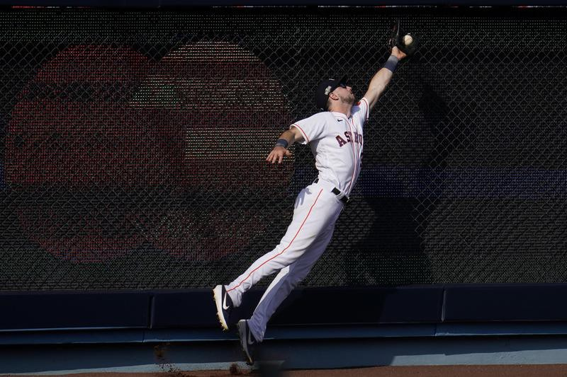 Kyle Tucker of Houston Astros catches a fly ball hit by Oakland Athletics