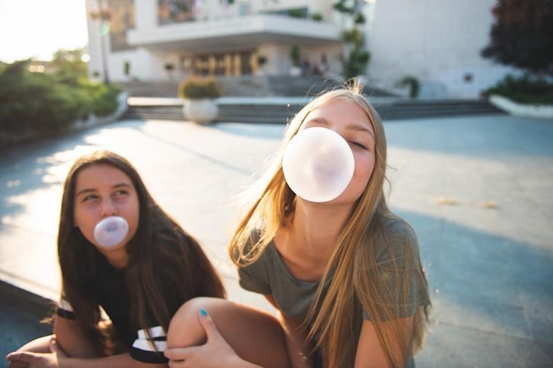 teens chewing gum