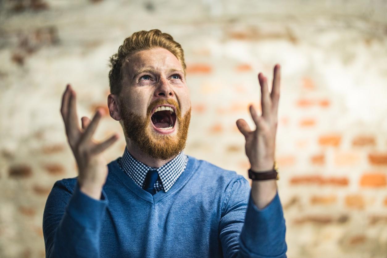 Angry man shouting at sky