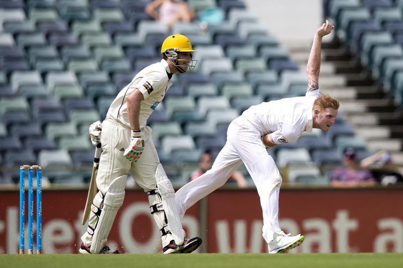 Ben Stokes bowls during tour cricket match
