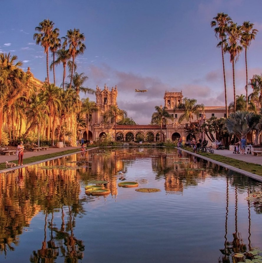 View by water of Balboa Park at sunset