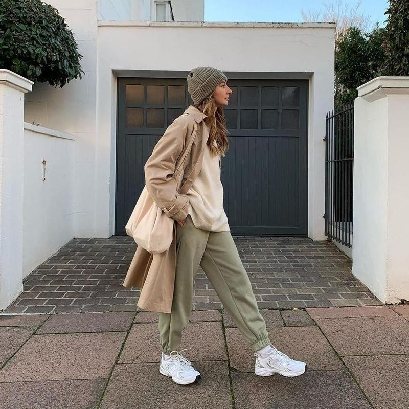 Woman outside home in oversized outfit