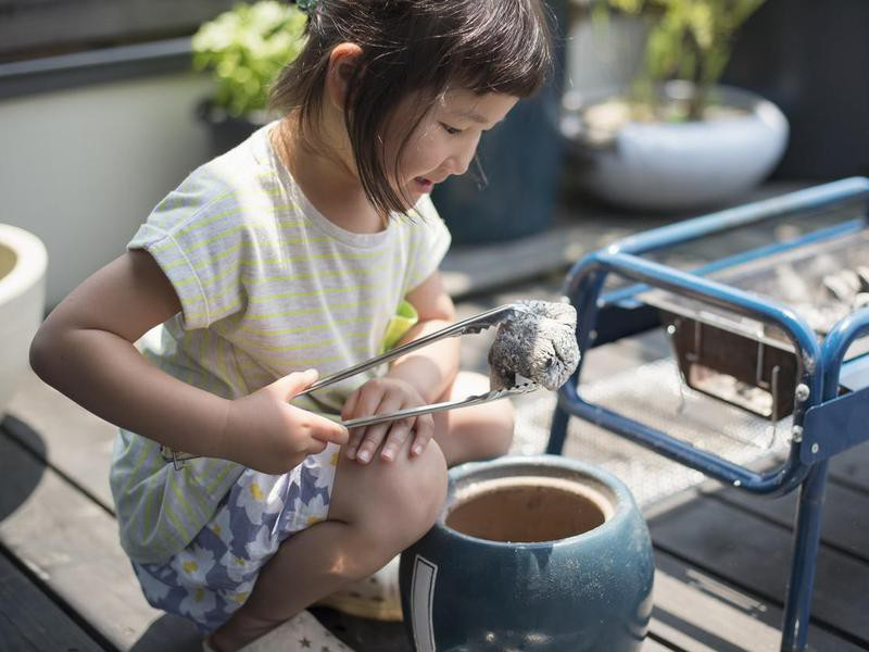 Girl playing with tongs