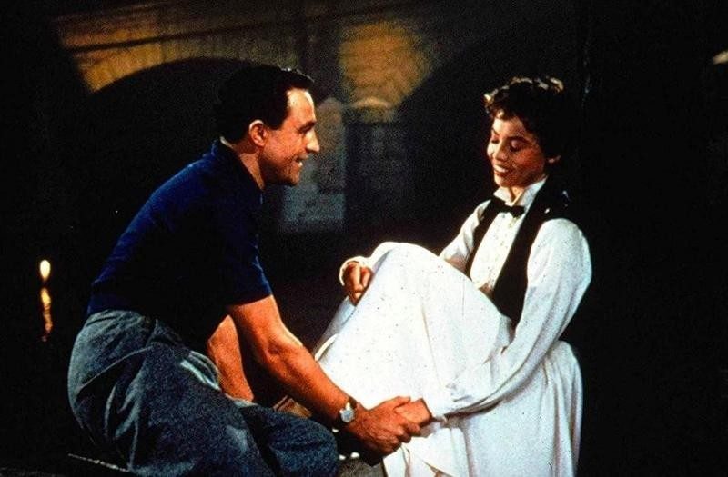 Gene Kelly and Leslie Caron interacting in An American in Paris