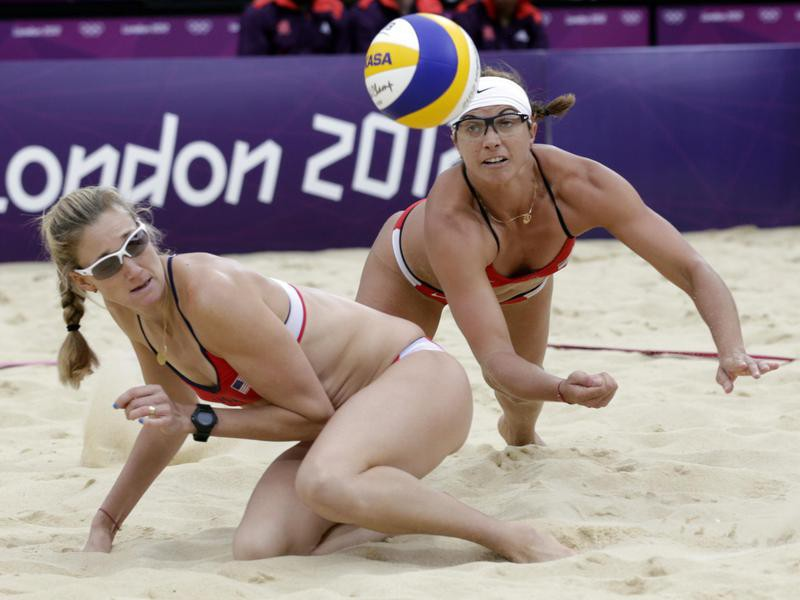 Misty May Treanor dives over her teammate Kerri Walsh Jennings