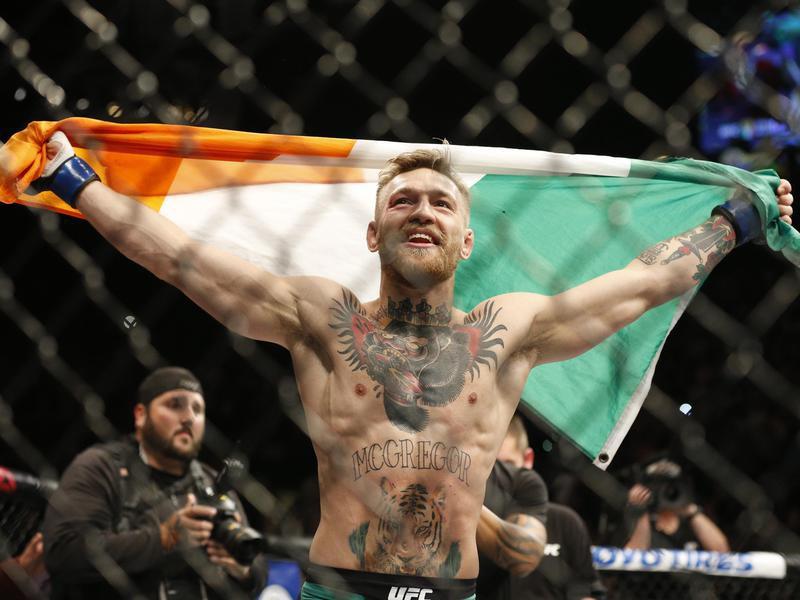 Conor McGregor reacts after defeating Jose Aldo