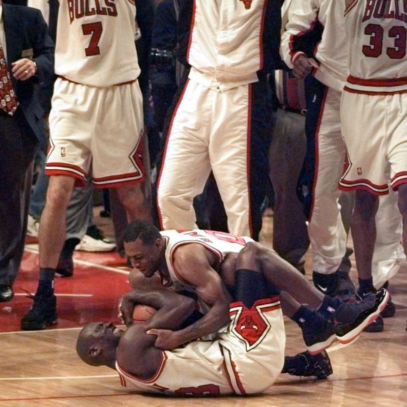 Randy Brown hugs Michael Jordan after winning the NBA championship