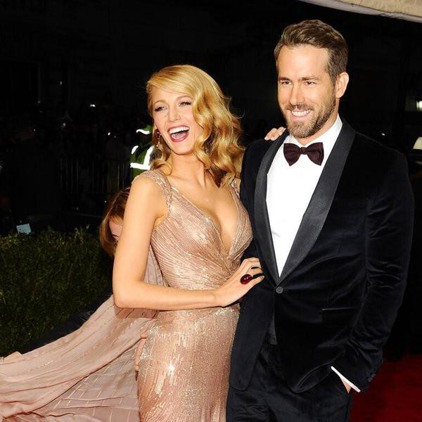 """Blake Lively and Ryan Reynolds attend The Metropolitan Museum of Art's Costume Institute benefit gala celebrating """"Charles James: Beyond Fashion"""" on Monday, May 5, 2014, in New York. (Photo by Charles Sykes/Invision/AP)"""