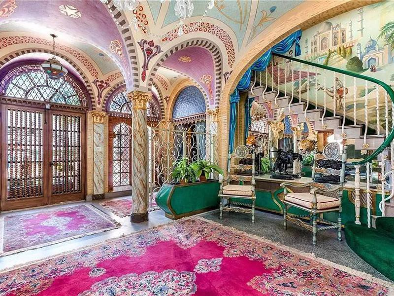 Lavishly decorated entryway and staircase