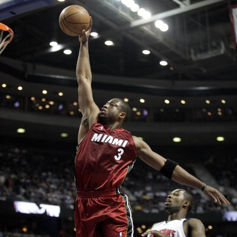 Dwyane Wade dunks in front of Detroit Pistons guard Rodney Stuckey