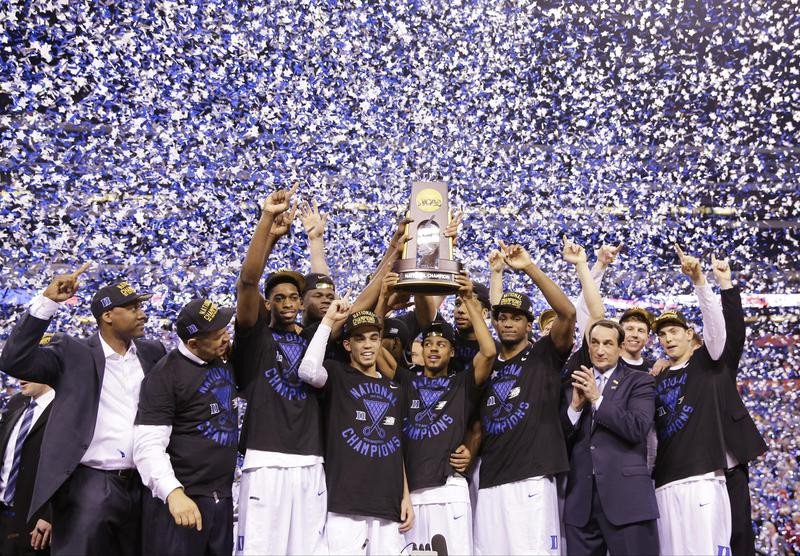 Duke players celebrate with trophy after win over Wisconsin