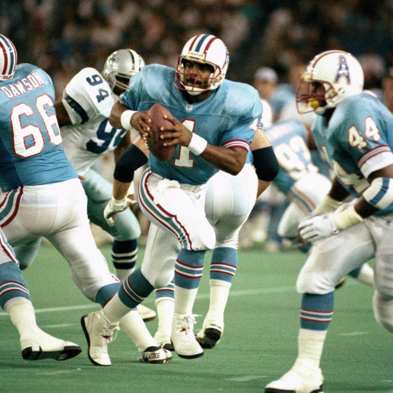 Warren Moon of Houston draws back and looks for receiver