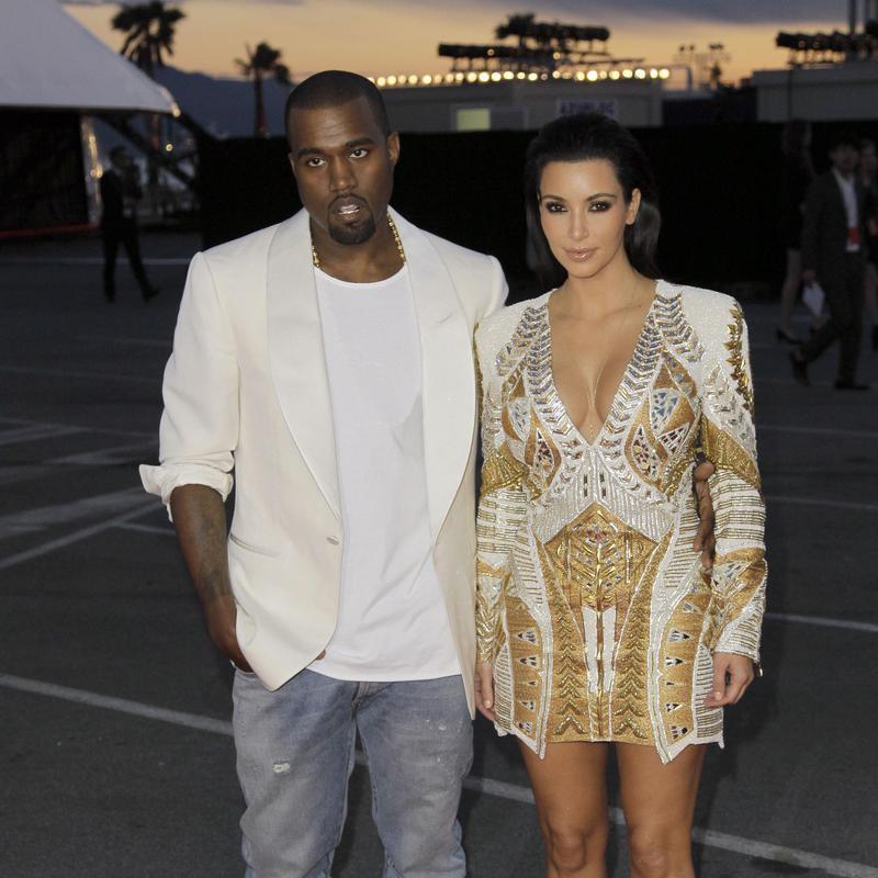 Kanye West and Kim Kardashian arrive