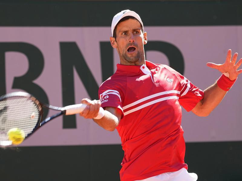 Serbia's Novak Djokovic slams a forehand