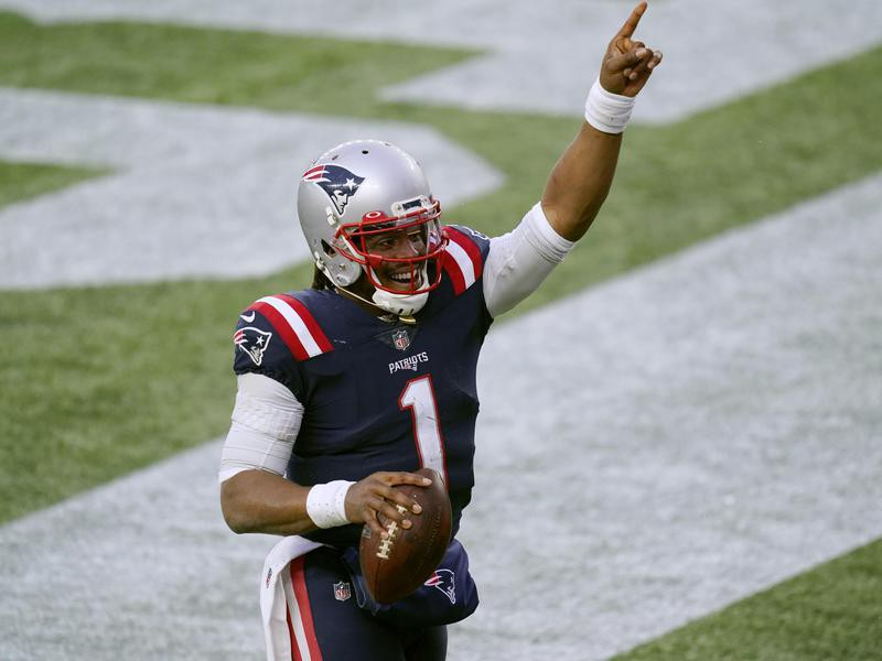 Cam Newton of the New England Patriots celebrates touchdown catch