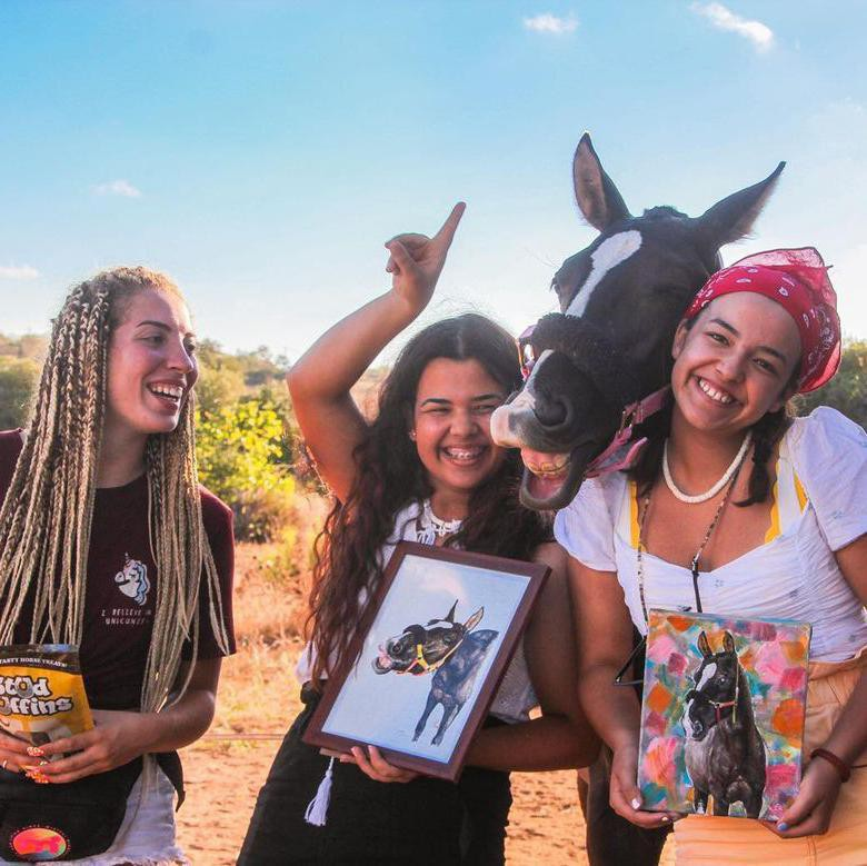 Girls Posing with Horse and Horse Paintings
