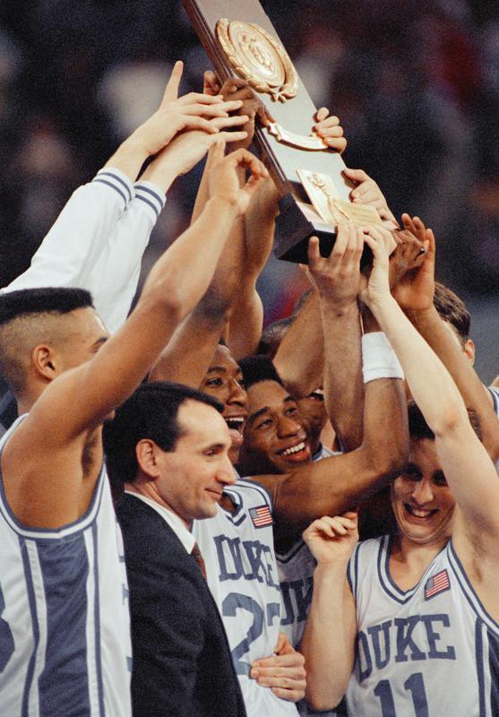 Duke coach Mike Krzyzewski and players celebrate