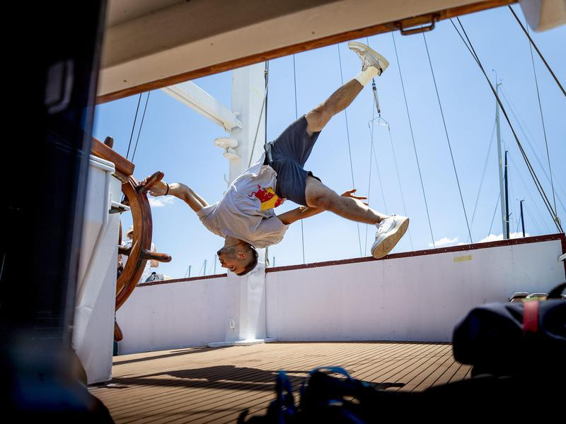 Dimitris Kyrsanidis holds ship wheel to do trick