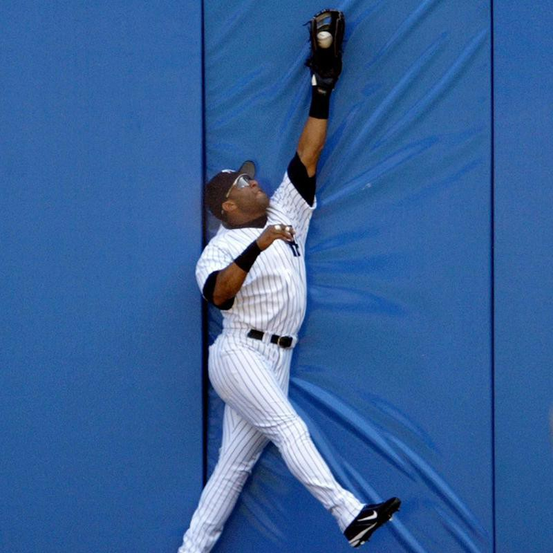 Gary Sheffield leaps to catch a ball