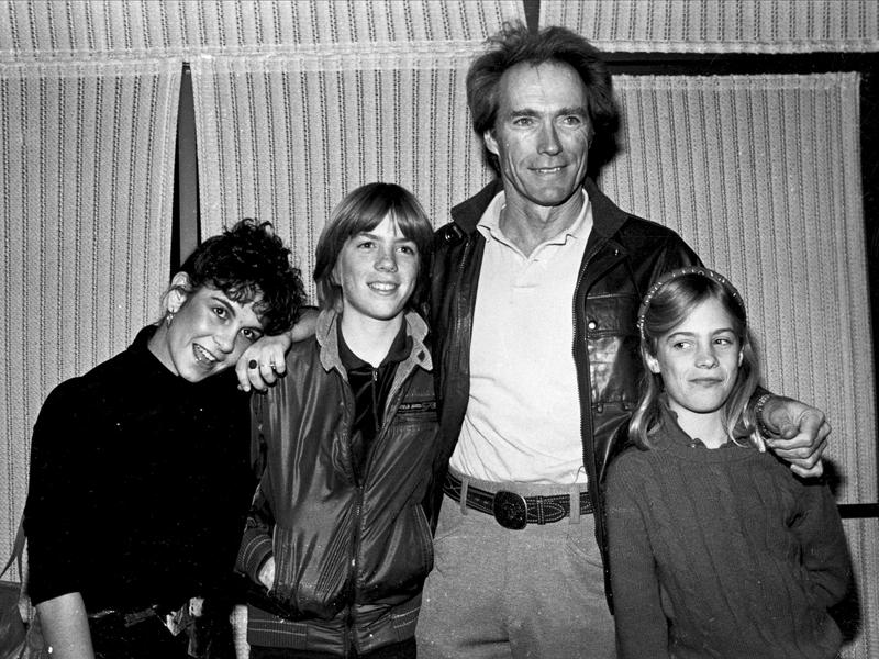 """Clint Eastwood stands with with Alexa Kenin (left), his son Kyle (middle left) and his daughter Alison (right) at a screening of his movie """"Honkytonk Man"""" in 1982."""