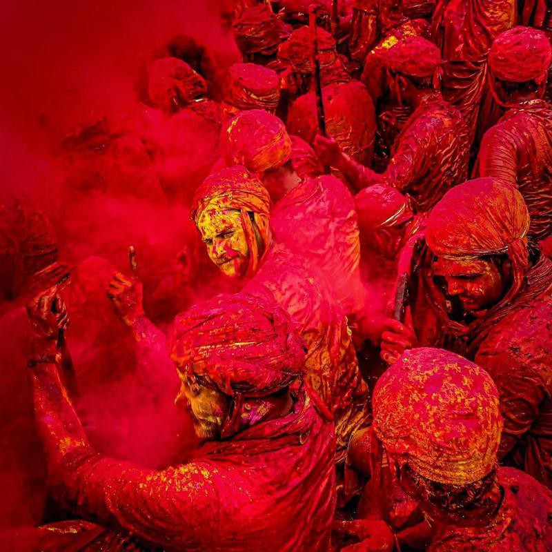 People covered in colors during Holi
