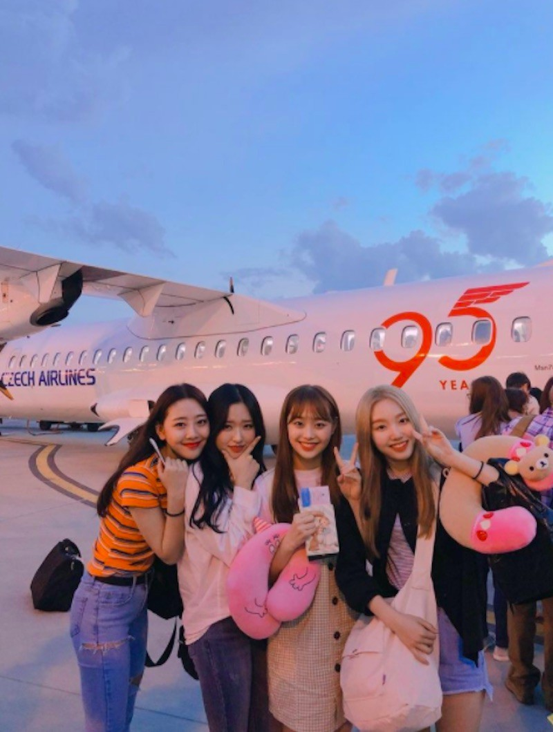People posing by Czech Airlines aircraft