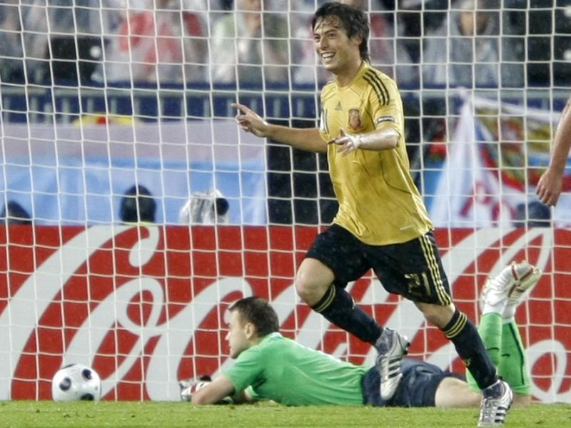 Spain's David Silva, foreground, celebrates scoring a goal against Russia.