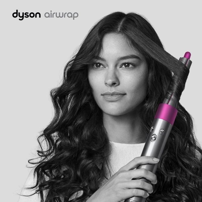 Woman using Dyson Airwrap