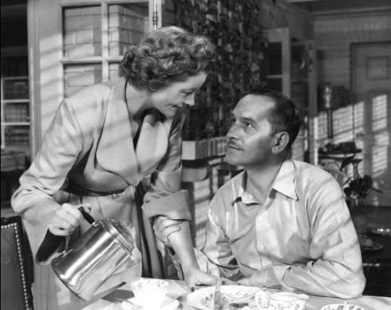 Myrna Loy pouring tea for Fredric March in The Best Years of Our Lives
