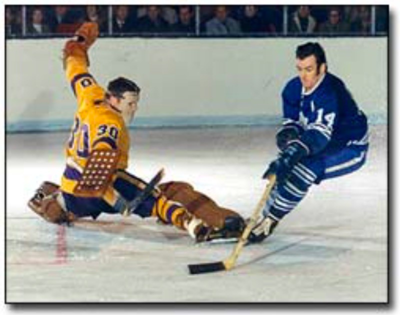 Dave Keon skates with puck