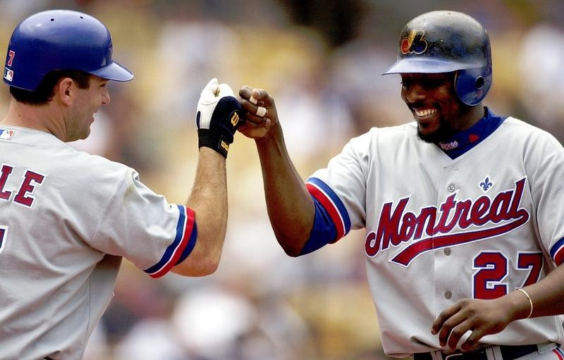 Vladimir Guerrero celebrates with teammate after hitting home run for Montreal Expos