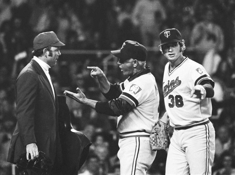 Gene Mauch argues with umpire